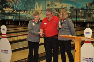 Cutting the Ribbon to Open the Tournament, Sharon  Schildroth, Association Manager, Dick Strange, West Michigan President, Merry DeBoer, Michigan State President